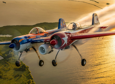 Two planes fly side by side during Airventure in Oshkosh
